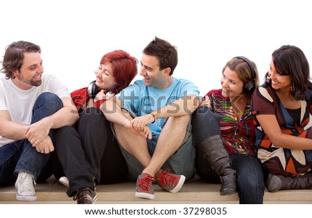 Group of friends sitting on the floor isolated #37298035
