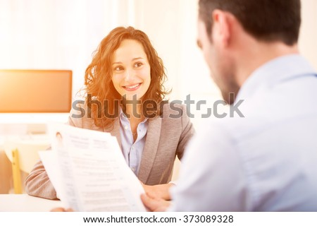 Young attractive woman during job interview #373089328