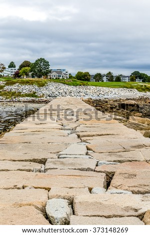 Stone Pier Toward House in Rockland Maine #373148269