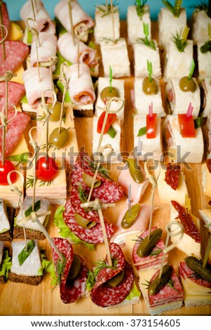 Different kinds of snacks canape on skewers. Selective focus. Toned. #373154605
