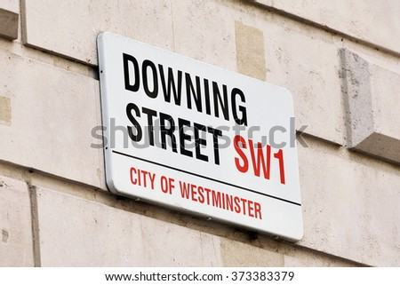 Sign on Downing Street in the City of Westminster in London England #373383379