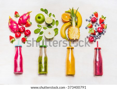 Assortment of fruit  and vegetables smoothies in glass bottles with straws on white wooden background. Fresh organic Smoothie ingredients. Superfoods and health or detox  diet food concept. #373400791