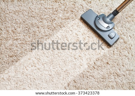 Cleaning carpet hoover Royalty-Free Stock Photo #373423378