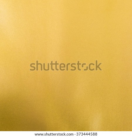 Gold foil leaf shiny wrapping paper texture background for wall paper decoration element #373444588