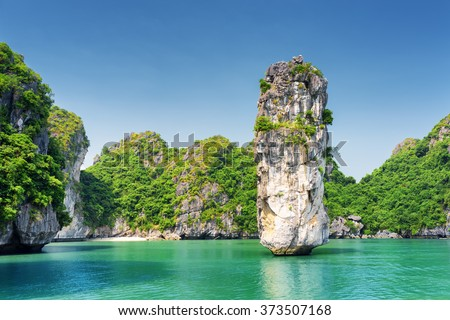 Amazing rock pillar and azure water in the Ha Long Bay (Descending Dragon Bay) at the Gulf of Tonkin of the South China Sea, Vietnam. The Halong Bay is a popular tourist destination of Asia. Royalty-Free Stock Photo #373507168
