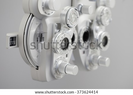 Phoropter, ophthalmic testing device machine Royalty-Free Stock Photo #373624414