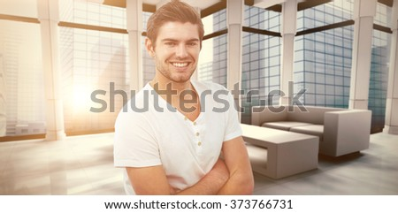 Handsome man against modern room overlooking city #373766731
