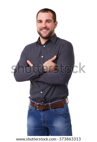Smiling man in black shirt with crossed arms. Isolated on white background #373863313
