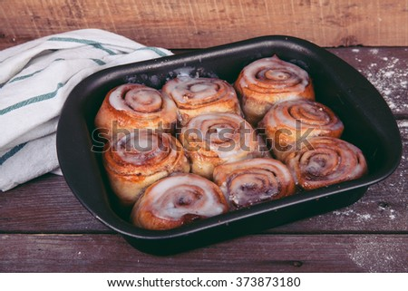 cinnamon rolls on a wooden background #373873180