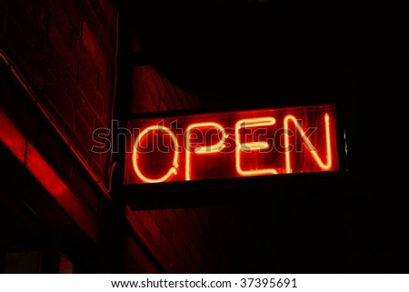 Red open neon sign glowing in the night