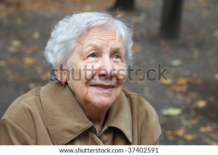 Beautiful portrait of an elder woman outdoors #37402591