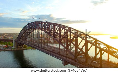 Sydney Harbour Bridge at sunrise, aerial view. Royalty-Free Stock Photo #374054767