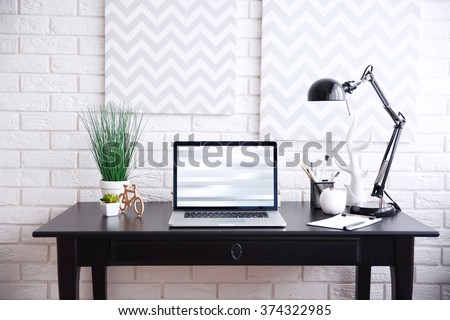 Workplace with laptop on table at home #374322985