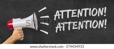 A man holding a megaphone - Attention Attention Royalty-Free Stock Photo #374434933