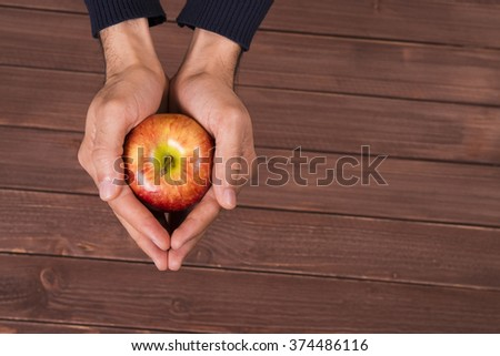 red apple on hand #374486116