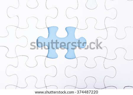 missing a piece of puzzle, blue space concept  #374487220
