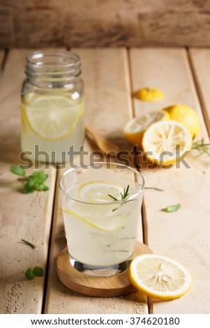 lemonade with fresh lemon and rosemary  #374620180