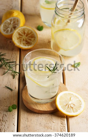 lemonade with fresh lemon and rosemary  #374620189