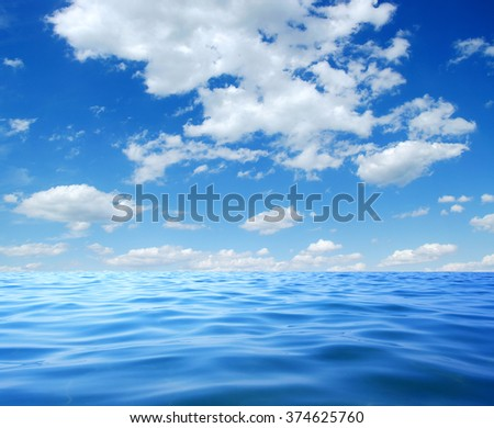 Blue sea water surface on sky #374625760