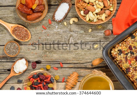 Granola bars ingredients on wood background. Gluten free. Top view. Copyspace background. Royalty-Free Stock Photo #374644600