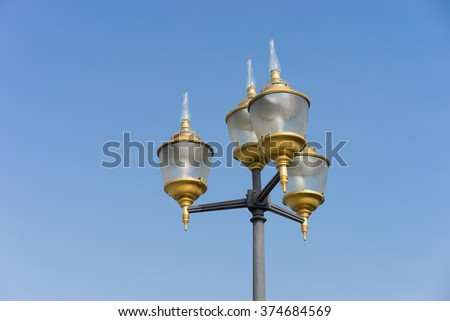 vintage lamp post in Thai style with blue sky  #374684569