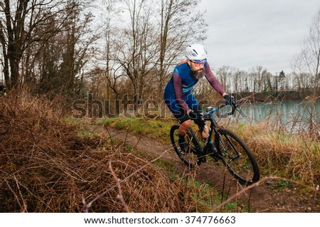 RIMSINGEN, GERMANY - February 7: Cyclocross competitors race against each other during a racing simulation in Rimsingen, Germany on 02/07/16.  #374776663
