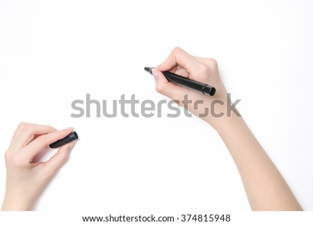Female hand is ready for drawing with black marker #374815948