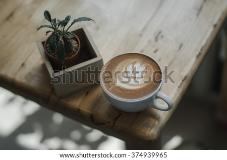Cup of coffee latte art in coffee shop on thailand Japaness&hipster Style #374939965