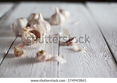 Fresh Garlic on the Wooden Table. Selective focus #374943865