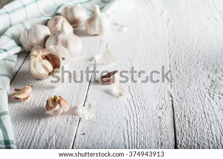 Fresh Garlic on the Wooden Table. Selective focus #374943913