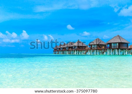 beach with water bungalows at Maldives #375097780