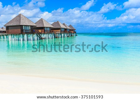 beach with water bungalows at Maldives #375101593