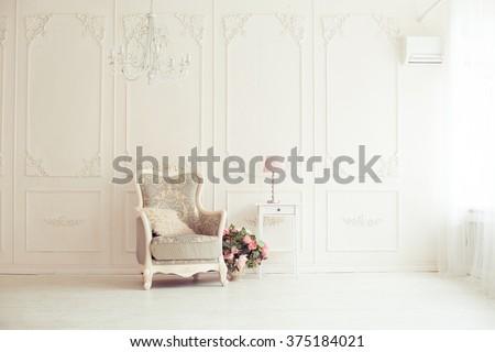 elegant armchair in luxury clean bright white interior #375184021