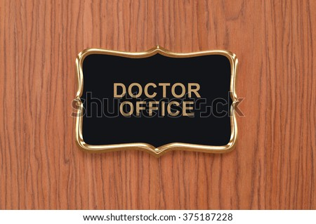 Close up of Doctor Office Sign on wood Door
