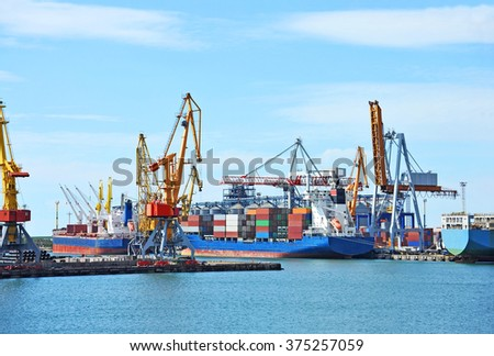 Container stack and ship under crane bridge #375257059