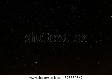 Starry black sky. In the center - the constellation of Orion #375352567