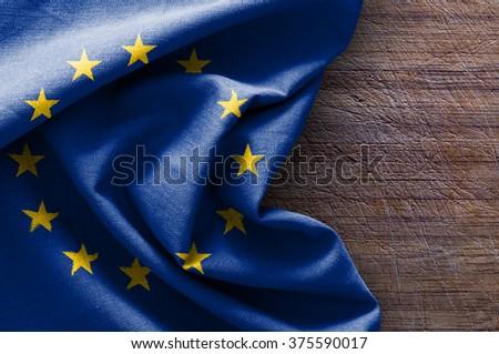 Flag of Europe on wood background Royalty-Free Stock Photo #375590017