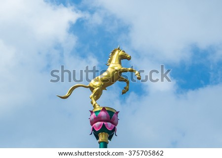 Golden horse statue to decorate at wayside in Thailand. #375705862
