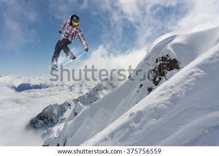 Flying snowboarder on mountains. Extreme sport. #375756559