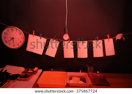 Dark room equipped under photo laboratory. Trays with reagents for printing by hand