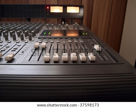 photo of channel volume controls of a recording studio mixing console