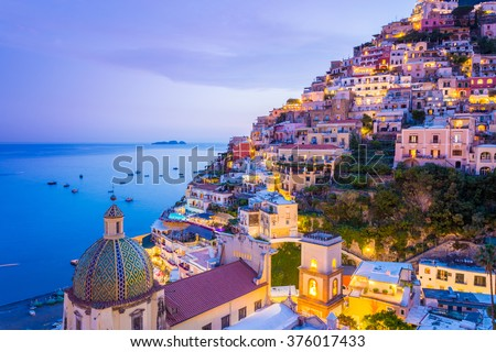 Positano, Amalfi Coast, Campania, Sorrento, Italy. View of the town and the seaside in a summer sunset Royalty-Free Stock Photo #376017433