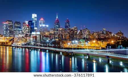 Philadelphia skyline by night reflected in Schuylkill river