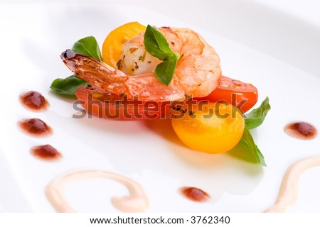 Closeup of spicy grilled shrimps and basil tomato salad served #3762340