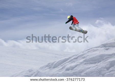 Flying snowboarder on mountains. Extreme sport. #376277173