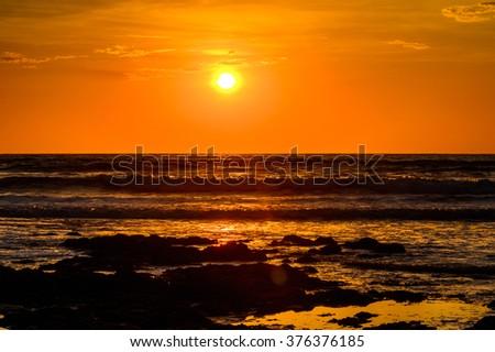 Sunset over the Atlantic Ocean in Swakopmund, Namibia #376376185