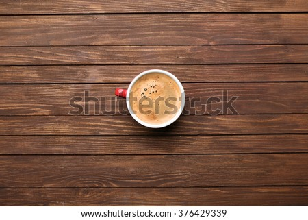 Cup of coffee on wooden table, top view #376429339