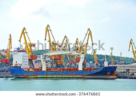 Bulk cargo ship under port crane bridge, Odessa, Ukraine #376476865