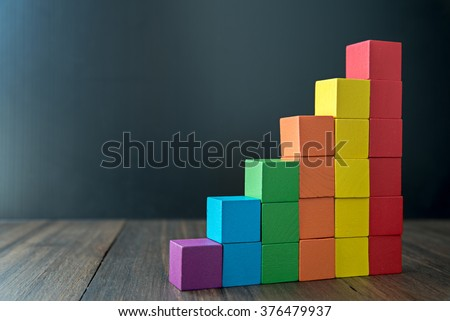 Colorful stack of wood cube building blocks Royalty-Free Stock Photo #376479937