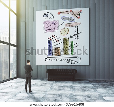Businessman looks at the poster with business graphs in modern office with leather sofa and big window 3D Render #376615408